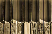 Closeup broken piano keys in sepia toned — Stock Photo