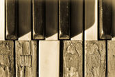 Closeup old piano keys in sepia toned — Stock Photo