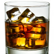 Whiskey with ice cubes in glass — Stock Photo
