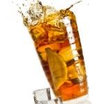 Ice splash in a glass with lemon tea — Stock Photo