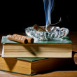 Blue smoke from cigar with ashtray and two books volume — Stock Photo #9039548
