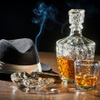 Retro scene, hat, smoking cigar and whisky with carafe — Stock Photo