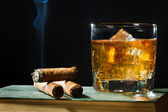Tree cigar and whisky with ice in glass — 图库照片