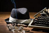 Old manual typewriter cigar and hat — Stock Photo