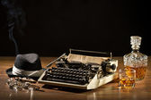Retro-Styled old typewriter, cigar, hat and whisky with carafe — Стоковое фото