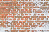 Old snowy wall made from red brick — Stock Photo