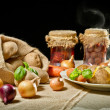 Jacket potatoes and roasted meal as rural meal concept - Stock Photo