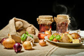 Jacket potatoes and roasted meal as rural meal concept — Stock Photo