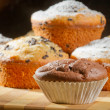 Some muffins with caster sugar - Stock Photo