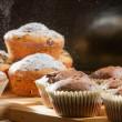 Falling sugar on vanilla muffins - Stock Photo