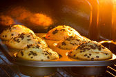 Baking tray with muffins in hot oven — Stock Photo