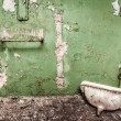 The abandoned room with sink and pipes - Stock Photo