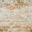 Stock Photo: Old brick wall with peeling paint