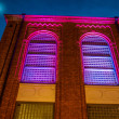 Stock Photo: Beautifully renovated building illuminated at night