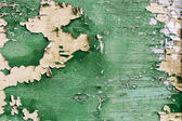 Old green plank with peeling paint — Stock Photo