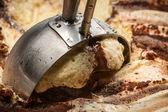 Ice cream and metallic spoon — Stock Photo