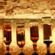 Royalty-Free Stock Photo: Six bottles on a bar