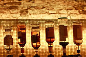 Six bottles on a bar — Stock Photo