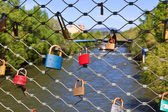Love locks on a bridge — Photo