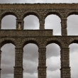 图库照片: Aqueduct in front of dark sky