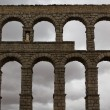 Stockfoto: Aqueduct in front of dark sky