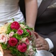 Wedding bouquet with couple — Stock Photo