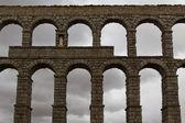 Aqueduct in front of dark sky — Stock Photo