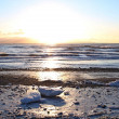 Icy beach at sunset — Stock Photo