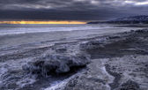Icy beach with storm clouds — Stock Photo