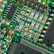 Stock Photo: PCB Closeup of green electronic circuit board and components