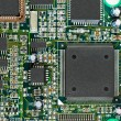 Closeup of electronic circuit board PCB with CPU processor - Stock Photo