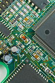 Closeup of green electronic circuit board PCB and components — Stock Photo
