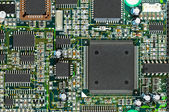 Closeup of electronic circuit board PCB with CPU processor — Stock Photo
