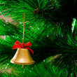 Bell hanging on Christmas tree — Stock Photo #7965391