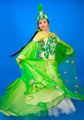 Fun, beautiful girl in traditional dress dancing Uzbek dance — Stock Photo