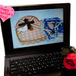 Rose and heart on a laptop — Stock Photo