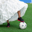 Bride playing football — Stock Photo #8817828