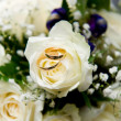 Stock Photo: Wedding rings with white rose