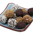 Stock Photo: Varied chocolate bonbons in blue bowl