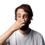 Man covers his nose — Stock Photo