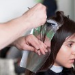 Hairdresser applying color to customer's hair. Selective focus. — Stock Photo