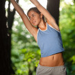 Fit young woman stretching — Stock Photo