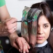 Hairdresser coloring woman's hair. Selective focus — Stock Photo #10447557