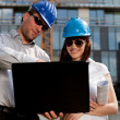 Stock Photo: Construction engineers / specialists planning at a construction
