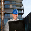 Happy construction engineer on construction site - Stock Photo