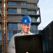 Happy construction engineer on construction site - Stok fotoğraf