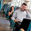 Stock Photo: Handsome businessmworking on train
