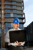 Happy construction engineer on construction site — Stock Photo