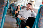 Handsome businessman working on the train — Stock Photo