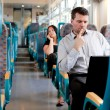 Stock Photo: Pensive businessmworking on train